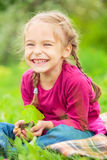 Little girl holding little green plant in her hands Stock Photos