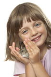 Little girl holding a little hamster Royalty Free Stock Images