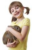 Little girl holding little rabbit Royalty Free Stock Images