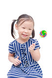 Little girl holding lollipop over white Stock Photography