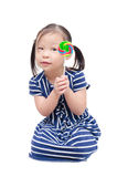 Little girl holding lollipop over white Stock Image