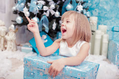 Little  girl holding a magic Christmas gift box Royalty Free Stock Image