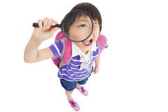 Little girl holding magnifier Royalty Free Stock Image