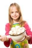 Little girl holding metal pot with mushrooms Stock Photos