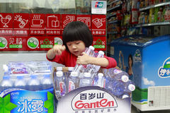 Little girl holding mineral water Stock Photos