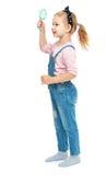 Little girl holding a mirror Stock Photos