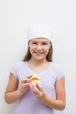 Little girl holding model teeth Stock Images
