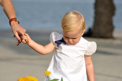 A little girl holding mother hand Royalty Free Stock Photography