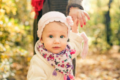 Little girl holding mothers hand. Spring toddler portrait. Stock Photo