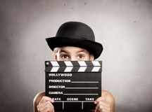 Little girl holding a movie clapper board Royalty Free Stock Photos
