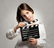 Little girl holding a movie clapper board Royalty Free Stock Photo