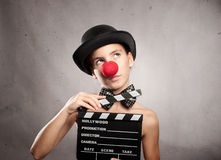 Little girl holding a movie clapper Royalty Free Stock Images