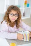 Little girl holding mug royalty free stock photos