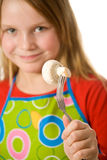 Little girl holding mushroom Stock Photo