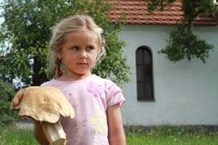 Little girl holding the mushroom royalty free stock photos