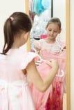 Little girl holding new dress Stock Photos