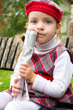 Little girl holding newspaper. Cute little girl holding newspaper at the park Royalty Free Stock Images