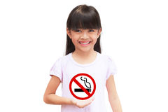 Little girl holding a no smoking sign. Isolated on white Stock Image