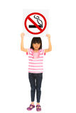 Little girl holding a no smoking sign. Isolated on white Royalty Free Stock Photos