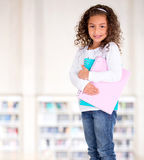 Little girl holding notebooks Royalty Free Stock Image