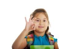 Little girl holding notebooks Stock Photography