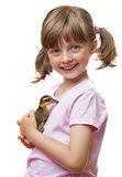 Little girl holding one duckling royalty free stock photo