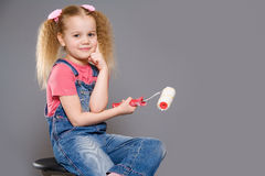 Little girl holding paint roller Royalty Free Stock Photography