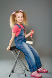 Little girl holding paint roller Stock Image
