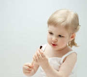 The little girl holding a paintbrush Stock Photos