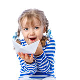 Little girl holding a paper boat on a white backgr Stock Photos