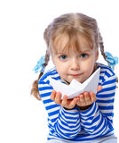 Little girl holding a paper boat on a white backgr Stock Image