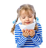Little girl holding a paper boat on a white backgr Royalty Free Stock Images