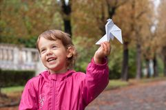 Little girl holding a paper dove Stock Photos