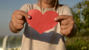 Little girl holding a paper heart stock footage