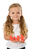 Little girl holding paper people family Royalty Free Stock Images