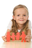 Little girl holding paper people - family concept. Little girl smiling and holding paper people - family concept stock photos