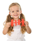Little girl holding paper people - family concept. Little happy girl holding paper people - united family concept, isolated royalty free stock photography