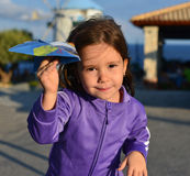 Little girl holding a paper plane Stock Image