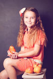 Little Girl holding Pear Fruit Royalty Free Stock Photo