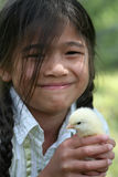 Little girl holding pet chick Stock Image