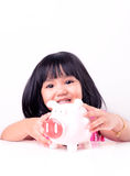 Little girl holding piggy bank Royalty Free Stock Image