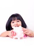 Little girl holding piggy bank Royalty Free Stock Image