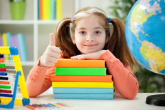 Little girl holding pile of books Royalty Free Stock Image