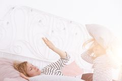 Little girl holding pillow Stock Photography