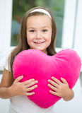 Little girl holding a pillow Stock Photo
