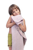 Little girl, holding pink blanket, studio shot Royalty Free Stock Image