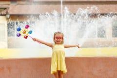 Little girl holding pinwheel Stock Image