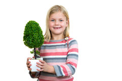 Little girl holding a plant. white background Royalty Free Stock Photography