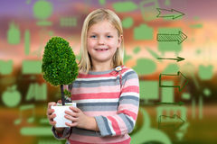 Little girl holding a plant. white background Stock Photo