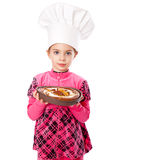A little girl is holding a plate of pie Royalty Free Stock Photos